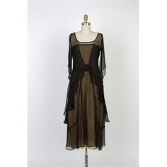 Bewitching Black and Gold Nataya Vintage Inspired Dress.Stunning new colors available for all of your holiday events. Vintage inspired fashions for the modern woman of sophistication.You will fine many more fashions just for your vintage soul at BlanchesPlace.com