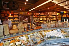 Vienna Naschmarkt cheese shop with fine walls of cheese shelves. Chocolate Fish travel photos