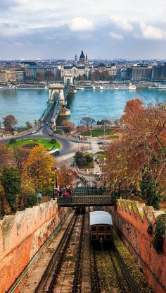 My dad loved Budapest, Hungary - Climbing Castle Hill. A tram makes its way up Castle Hill in Budapest with the Chain Bridge in the background. Places Around The World, The Places Youll Go, Travel Around The World, Places To See, Around The Worlds, Beautiful World, Beautiful Places, Amazing Places, Beautiful Boys