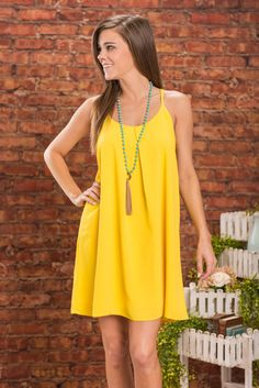 Frist Peek Dress, Lemon || Your first peek at this bright lemony dress will certainly not be your last! It will always keep you coming back for more! But not just because of the cherry color! You'll also love the amazing fit!