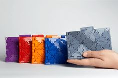 Mixee Labs Produces Sleek, Sophisticated 3D Printed Line of Purses and Wallets http://3dprint.com/36409/mixee-labs-3d-printed-purses/