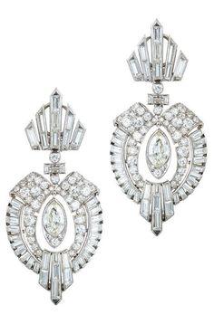 A pair of Art Deco diamond and platinum earrings, circa 1930. #ArtDeco #earrings