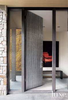 Architect Eric Cummings and interior designer Catherine Frank took the simplicity of this home and added elements to give it a more modern and rustic feel. Featured in our Colorado Fall 2010 issue.  An embossed-metal front door, designed by Crawford artist Don Giminaro to mimic the surrounding  aspen trees, opens to reveal an oilon-  canvas painting by Todd Murphy.