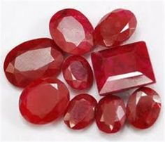 Rubies... I like the looks of the ones that have a slight cloudy look to the stone...