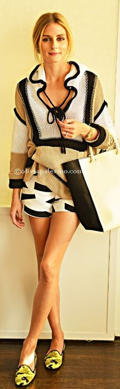 Who made Olivia Palermo's white print shorts, tan hooded sweater, black handbag, and green print shoes?