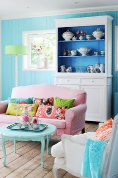 The blue shelf against the turquoise wall really pops. Love the pastels in the room.
