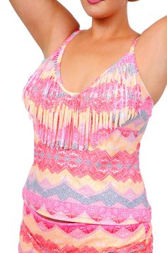 Coral or Lavender hues accentuate the scalloped batik print and fringe along the neckline creates an updated look on the Jessica Simpson Separates Goa Fringe Tankini Top #GO149401.PLEASE NOTE THAT TH