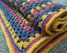 Tutti Frutti striped hand crocheted baby blanket. by Twiddliebits