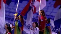 Penny Oleksiak proudly carries Canada's flag into the closing ceremony