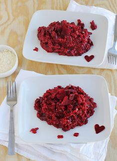 (Heart)Beet Risotto. serves two as a meal or four as side.  1 cup arborio rice 2 small beets (plus another to make the hearts for garnish, optional) 1 small red onion 1/2 cup red wine (any kind you prefer will do) 2 3/4 cup vegetable stock 2 tablespoons butter 1 tablespoon olive oil 1/2 cup parmesan cheese salt + pepper
