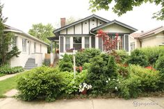 A beautiful garden fills the front yard of this vintage two-bedroom, two-bath bungalow.  See more at Zillow »   - HouseBeautiful.com