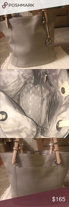 """AUTHENTIC MICHAEL KORS JET SET TOTE! ⭐️⭐️This beautiful gray bag is in EXCELLENT condition... like new! Gray is a very rare color for the jet set tote! Measures 15"""" in length and 10.5 """" in height! Tons of room including a back pocket, 4 multi-function pockets and an interior zipper pocket!! Just an awesome bag!! ⭐️⭐️ Michael Kors Bags Totes"""