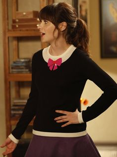 Zooey Deschanel's black and pink bow sweater on New Girl