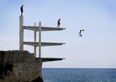 MOST UPLIFTING PHOTOS 2014   © Provided by Time Article   People dive into the Mediterranean Sea on a hot summer's day in Nice, southern France, 21 July 2014.