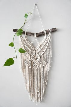 Medium Macrame Wall hanging. A fusion knots and of course lots of fringing! Your piece is made by hand using natural unbleached cotton and revived branches from local woods in Upstate NY and the Adirondacks. This is an example of a finished piece. The pattern will be the same, but due to the beauty of mother nature, the branch will be different. This makes each piece wonderfully unique to you and your home, so she is sure to stand out wherever you choose to hang her. ✨✨✨ SIZING Size is…