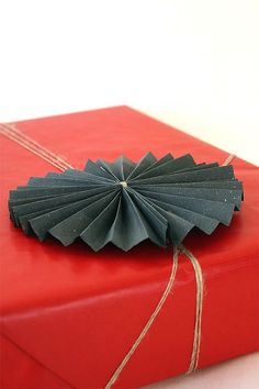 DIY Folded Paper & Twine Gift Wrap. Includes a number of fun ideas for gift wrapping presents.
