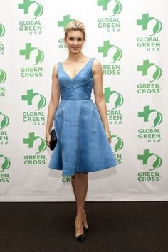 Sustainable blue cocktail dress worn by Maggie Grace. This dress is made of fabric woven from abaca and pineapple leaf fibers!