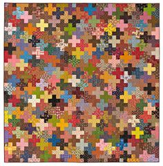 "Charming Addition: Dig into your stash to create a quilt that's positively ""scraptacular""."
