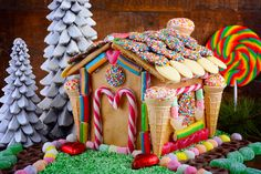 Buy Festive Gingerbread House by MillefloreImages on PhotoDune. Festive Christmas Gingerbread House decorated with candy canes, marshmallow cones, chocolates and candy in a rustic d. Graham Cracker Gingerbread House, Cool Gingerbread Houses, Gingerbread Village, Christmas Gingerbread House, Christmas Cookies, All Things Christmas, Christmas Time, Christmas Crafts, Christmas Decorations