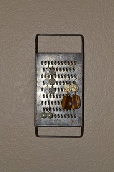 vintage cheese grater jewelry display