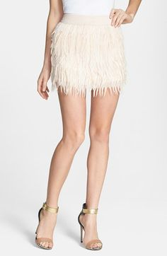 $99, Beige Fluffy Mini Skirt: PRESS Faux Feather Miniskirt. Sold by Nordstrom.
