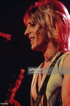 Guitarist and singer Mick Ronson  performs onstage at the Ford Auditorium on April 28, 1975 in Detroit, Michigan.