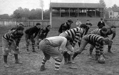 """COLLEGE FOOTBALL: 1900 Dickinson College squad.  In modern football parlance, they are in a T-formation backfield with the ends drawn in tight to the tackles. """"The stand seen in the photograph was built eight years earlier, seating 250 people, but burned down later and was not rebuilt."""""""