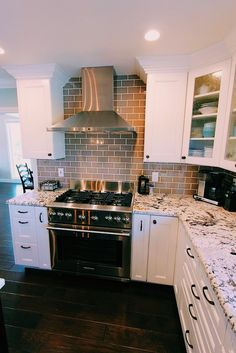 Oh my god   I don't think I would do White though. Perhaps a dark granite and wood cupboards