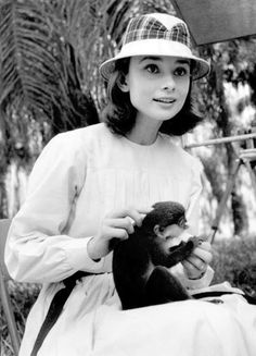 Audrey Hepburn and a Monkey, a strangely chic combo.