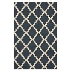 Anchor your living room seating group or define space in the den with this handcrafted wool rug, showcasing a chic trellis motif in charcoal. Made in India.   Product: RugConstruction Material: WoolColor: CharcoalFeatures:  HandcraftedTrellis motifMade in India  Note: Please be aware that actual colors may vary from those shown on your screen. Accent rugs may also not show the entire pattern that the corresponding area rugs have.