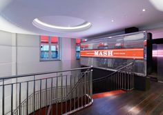 The latest photographs of MASH London. The helical staircase at the entrance leading down to the restaurant