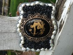 Beautiful vintage style buckle set with a unique vintage cameo edged in freshwater pearls