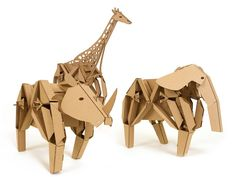 Build Your Walking Cardboard Animal Sculpture! Kinetic Creatures are a set of three walking cardboard animal sculptures. The Creatures, Elly the elephant, Rory the rhino, and Geno the giraffe, are each made up of cardboard pieces that you assemble using tabs-and-slots. By turning the wire handle the creatures come alive with a simple mechanical motion. They can even walk on their own with a gear kit.