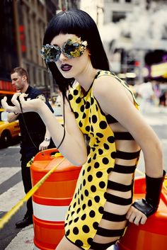 yellow and black outfit polka dot dress black hair crazy sunglasses bright clothing