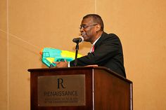 """Alumnus and famed inventor, Lonnie Johnson, sprays audience with Super Soaker water gun."""