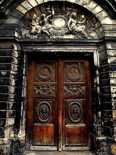 A grand portal to the Hotel Amelot Bisseuil, Marais area of Paris, France.  The pair of carved Medusas by Thomas Regnaudin (1622-1706)