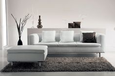 Maldive 3 seater leather sofa Sofa with wooden frame and metal base. Covered with soft leather.