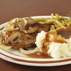 A hearty recipe for salisbury steak with fried onions and mushrooms, great served with mashed potatoes.. Salisbury Steak Recipe from Grandmothers Kitchen.