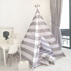This handmade childrens play tent is a complete set. Play mat base and two throw pillows included! It comes with a lightly padded floor mat and