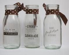 Small bottles where I've added rub-ons and ribbons. Cute gifts.