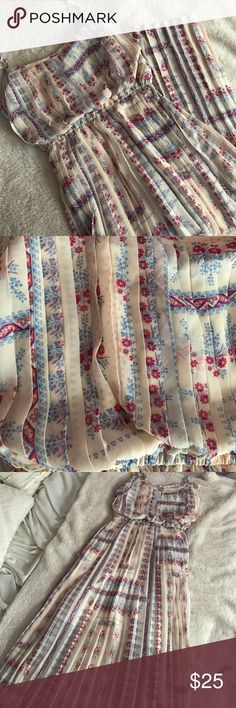 Floral Popover Pleated Maxi Dress Never worn! Beautiful pleating and goes great when you pair with a belt. Off white cream color pairs beautifully with reds and blues in this floral pattern. Shorter inside lining. American Rag Dresses Maxi