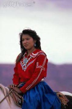 Navajo girl riding her horse.