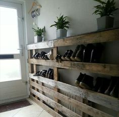 Turn a pallet into a shoe rack AND a plant holder in your garage. Saves space and prevents dirt from coming into the house!