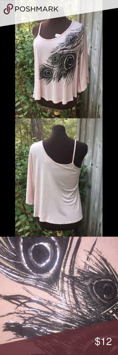 One shoulder feather top Rayon. Wash on gentle cycles. Made in the U.S.A. Worn only once! It's a very light pink color. The feathers are black and silver. Rue 21 Tops