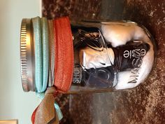 Mason Jar gift. Nail polish, remover pads with hair ties as a bow.