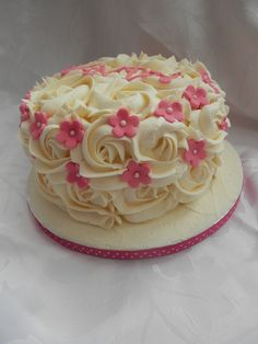 A very quick last minute cake with butter cream rose swirls and flower decoration as directed by my four year old!