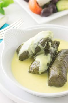 Lamb stuffed grape leaves with avgolemono sauce. Tender Greek dolmas filled with ground lamb,rice, and fresh herbs and swimming in a tangy egg-lemon sauce. Dolmas Recipe Greek, Dolmades Recipe, Greek Dolmades, Greek Lemon Sauce Recipe, Lebanese Recipes, Greek Recipes, Croatian Recipes, Hungarian Recipes, Best Lamb Recipes
