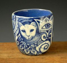 Blue and white hand painted OOAK porcelain cup tea bowl with faces, cat, eye and butterfly