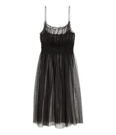 Black. Sheer dress in mesh with narrow shoulder straps, small ruffle trim at top, and smocking below bust. Unlined.