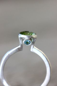 Apple Green Peridot and Swiss Blue Topaz Gemstone Solitaire Ring, Handmade Sterling Ring Made To Order. $198.00, via Etsy.